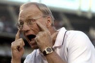 """FILE - San Diego Chargers coach Marty Schottenheimer gets his message across to his team during the first quarter of a preseason game against the Seattle Seahawks in San Diego, in this Friday, Aug. 27, 2004, file photo. Marty Schottenheimer, who won 200 regular-season games with four NFL teams thanks to his """"Martyball"""" brand of smash-mouth football but regularly fell short in the playoffs, has died. He was 77. Schottenheimer died Monday night, Feb. 8, 2021, at a hospice in Charlotte, North Carolina, his family said through Bob Moore, former Kansas City Chiefs publicist. (AP Photo/Denis Poroy, File)"""