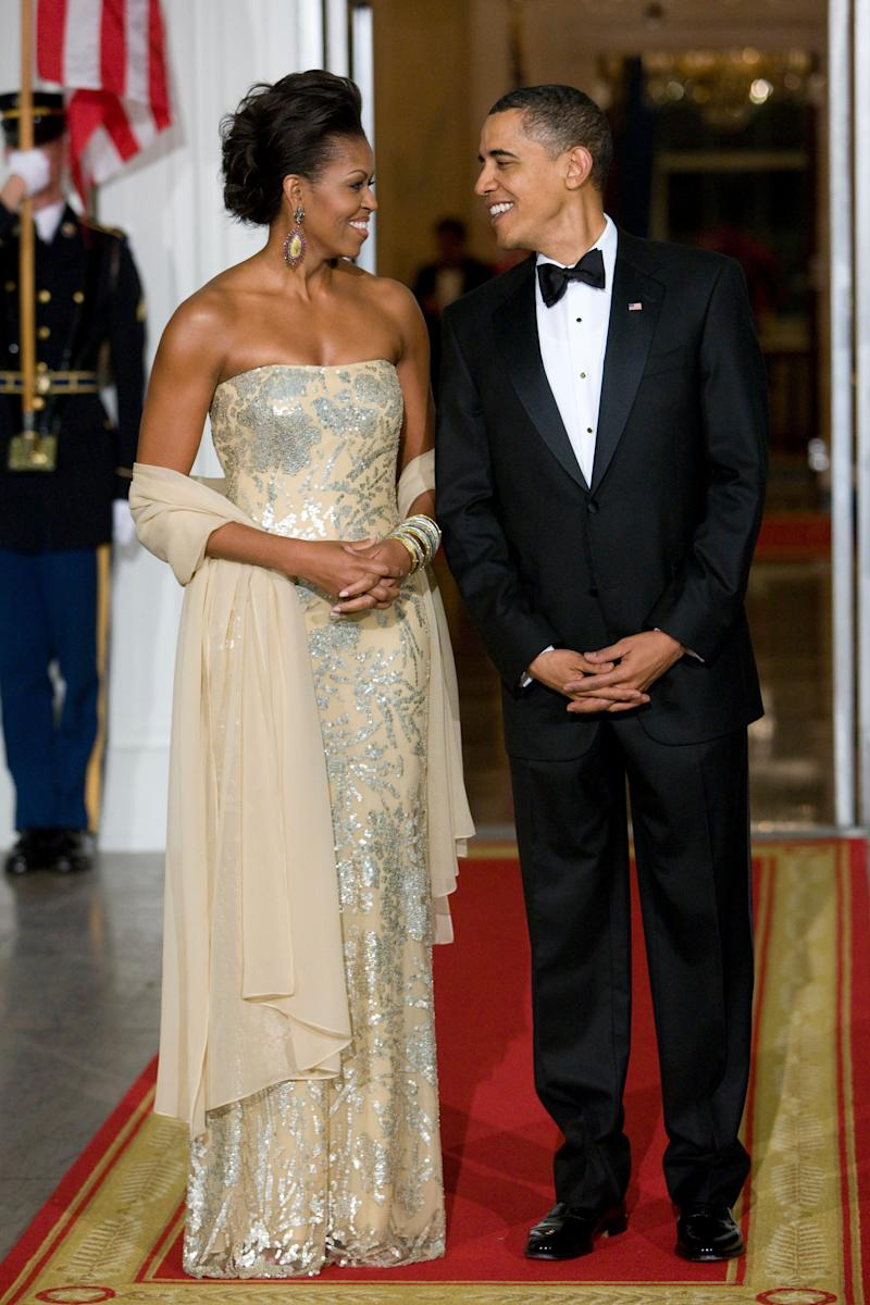 A stunning gown by Indian-American designer Naeem Khan, worn for a state dinner with Indian Prime Minister Manmohan Singh and his wife, Gursharan Kaur, in 2009.