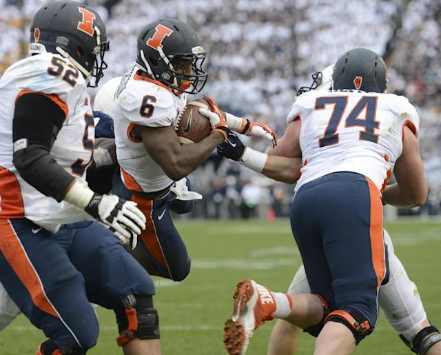 Illinois running back Josh Ferguson (6) scores a fourth quarter touchdown during an NCAA college football game against Penn State in State College, Pa., Saturday, Nov. 2, 2013. Blocking are Illinois offensive linesmen Alex Hill (52) and Michael Heitz (74). (AP Photo/John Beale)