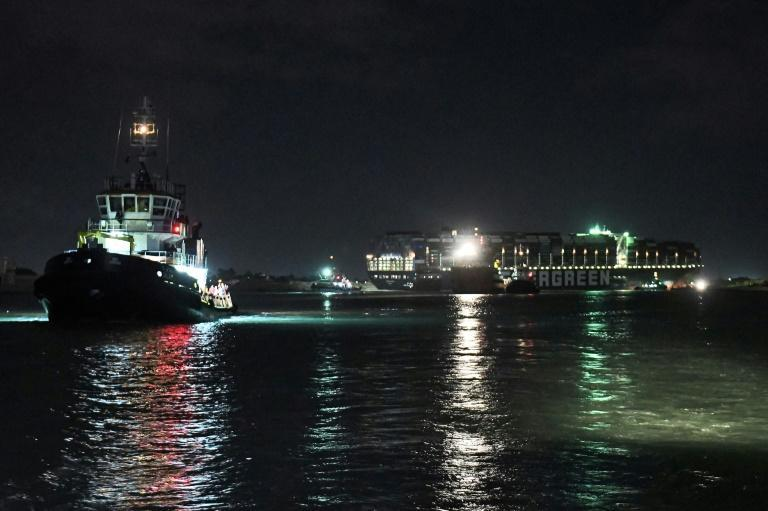 Tugboats work late into the night to dislodge the giant container ship that blocked traffic through the vital Suez Canal