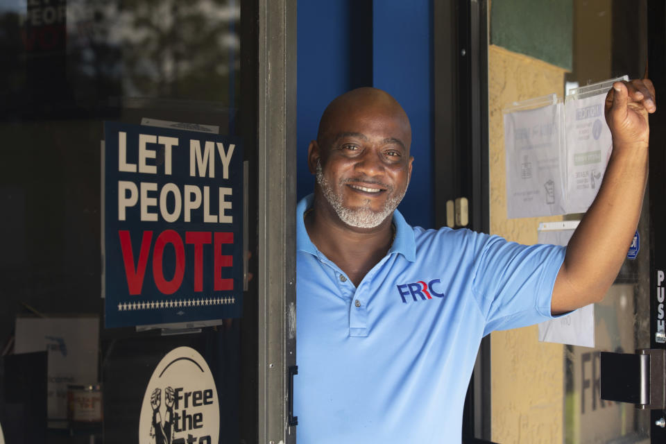 """In this photo provided by the John D. and Catherine T. MacArthur Foundation, Desmond Meade poses for a portrait Monday, Sept. 13, 2021 at the Florida Rights Restoration Coalition's headquarters in Orlando, Fla. The activist whose mission is to make sure people who walk out of prison are free to walk into the voting booth is among this year's MacArthur fellows and recipients of """"genius grants."""" (John D. and Catherine T. MacArthur Foundation via AP)"""