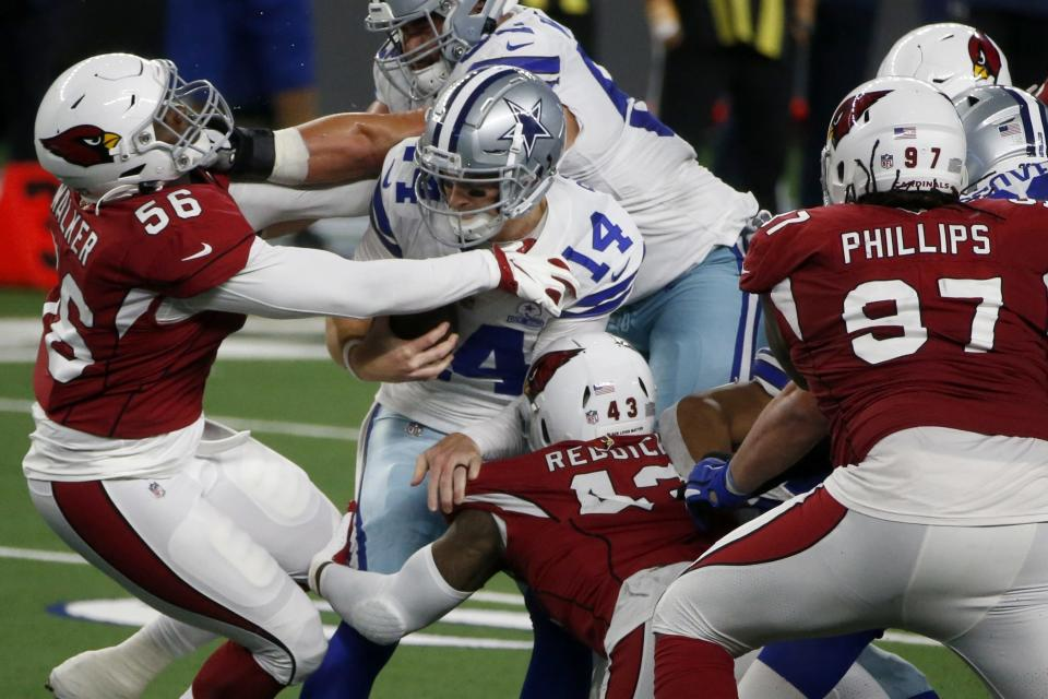 Arizona Cardinals' Reggie Walker (56), Haason Reddick (43) and Jordan Phillips (97) combine to sack Dallas Cowboys' Andy Dalton (14) in the second half of an NFL football game in Arlington, Texas, Monday, Oct. 19, 2020. (AP Photo/Michael Ainsworth)