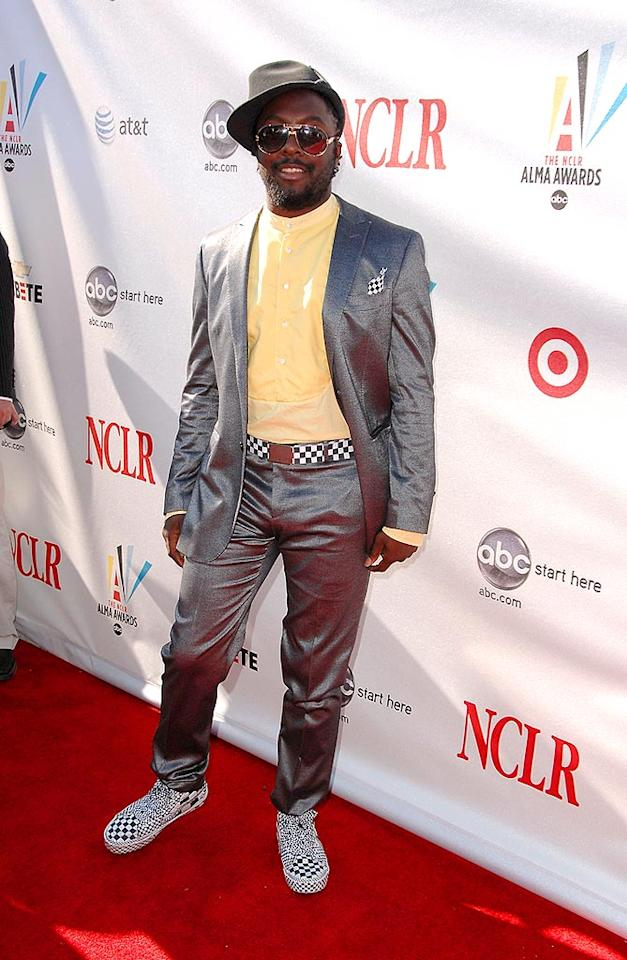 "As usual, will.i.am of the Black Eyed Peas stood out in a silver suit with black and white checkered accents. Steve Granitz/<a href=""http://www.wireimage.com"" target=""new"">WireImage.com</a> - August 17, 2008"
