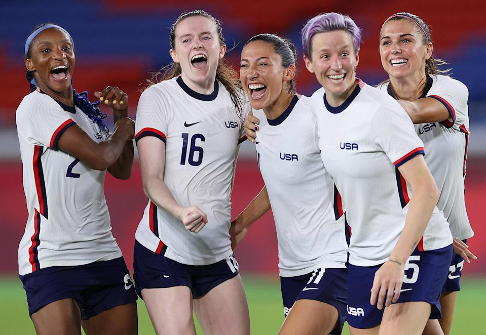 <p>Crystal Dunn, Rose Lavelle, Christen Press, Megan Rapinoe and Alex Morgan of Team USA's women's soccer team celebrate following their team's victory in the penalty shoot-out after their quarterfinal match against the Netherlands on July 30.</p>