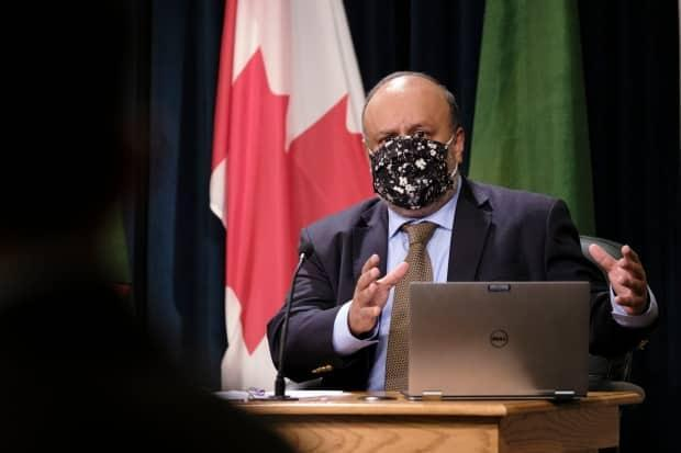 Experts say Saskatchewan's chief medical health oficer Dr. Saqib Shahab, pictured, can and must issue COVID-19 public health orders immediately to protect the public, even if Premier Scott Moe disagrees. (The Canadian Press - image credit)