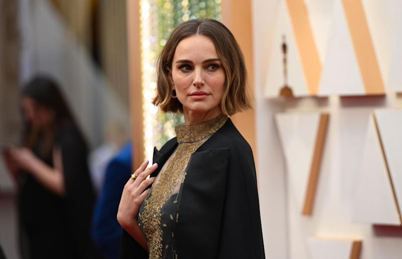 Natalie Portman on the red carpet, wearing the black Dior cape