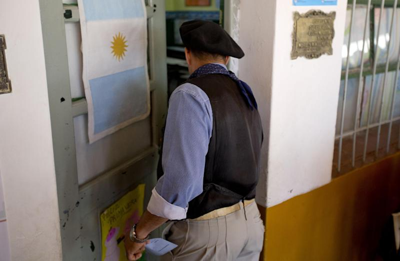 A man enters to vote at a polling station during mid term legislative elections in Buenos Aires' Tigre district, Argentina, Sunday, Oct. 27, 2013. Sunday's run-up to congressional elections will decide how much control President Cristina Fernandez will have over Argentine politics during the final two years of her presidency. (AP Photo/Natacha Pisarenko)