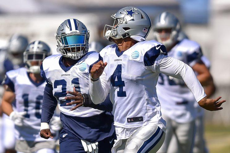 Dak Prescott and Ezekiel Elliott will try to lead Dallas to a second straight NFC East title. (AP)