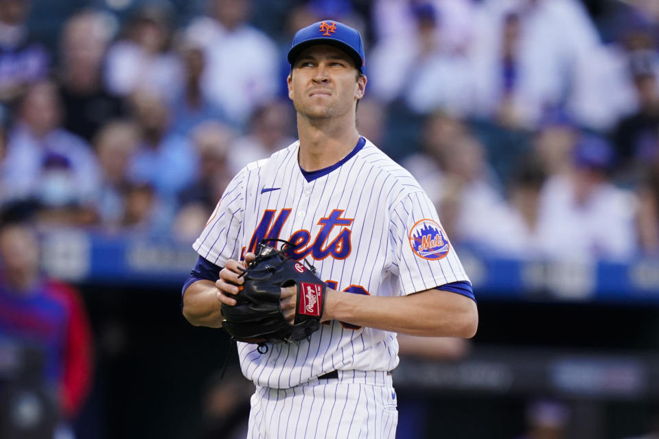 New York Mets starting pitcher Jacob deGrom reacts during the first inning of a baseball game against the Chicago Cubs Wednesday, June 16, 2021, in New York. (AP Photo/Frank Franklin II)