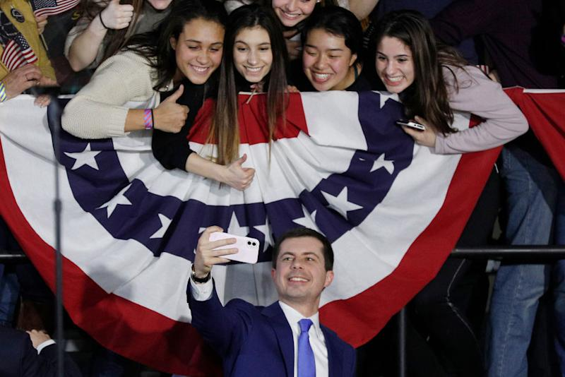 Four grinning young women in selfie with Pete Buttigieg.