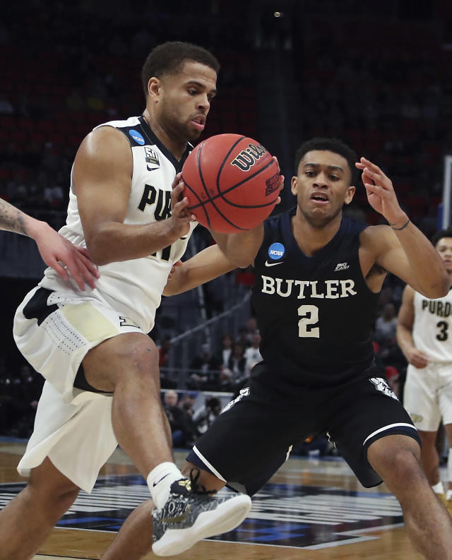 Purdue guard P.J. Thompson, left, controls the ball as Butler guard Aaron Thompson (2) defends during the first half of a second round game in the NCAA college basketball tournament, Sunday, March 18, 2018, in Detroit. (AP Photo/Carlos Osorio)