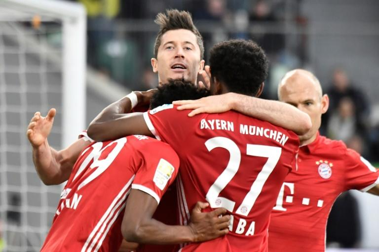 Bayern Munich celebrates after scoring during their German first division Bundesliga football match against Wolfsburg on April 29, 2017 in Wolfsburg, northern Germany