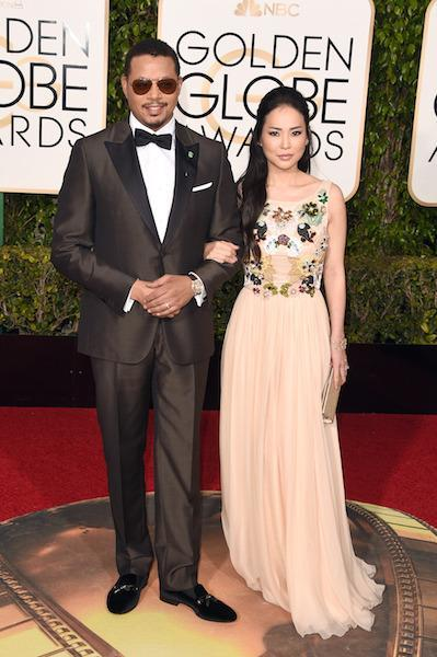 Terrence Howard in a metallic brown tuxedo at the 73rd Golden Globe Awards.