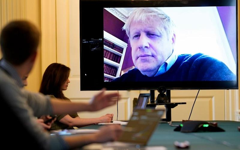 Boris Johnson had insisted it was business as usual, chairing meetings by conference call - Andrew Parsons/Number 10