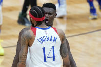 New Orleans Pelicans forward Zion Williamson, right, celebrates with forward Brandon Ingram (14) in the second half of an NBA basketball game against the Boston Celtics in New Orleans, Sunday, Feb. 21, 2021. (AP Photo/Gerald Herbert)