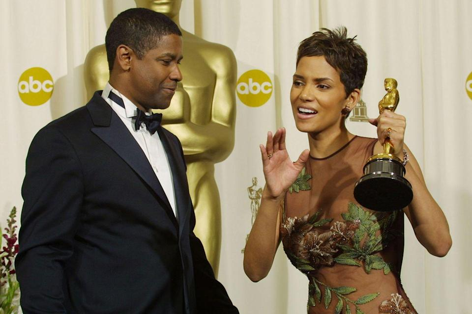 "<p>History was made when <a href=""https://www.goodhousekeeping.com/health/a43747/halle-berry-diet/"" rel=""nofollow noopener"" target=""_blank"" data-ylk=""slk:Halle Berry"" class=""link rapid-noclick-resp"">Halle Berry</a> became the first African American to win a Best Actress award for her role in <em><a href=""https://www.amazon.com/dp/B000XSEPX2?ref=sr_1_1_acs_kn_imdb_pa_dp&qid=1547580369&sr=1-1-acs&autoplay=0&tag=syn-yahoo-20&ascsubtag=%5Bartid%7C10055.g.5132%5Bsrc%7Cyahoo-us"" rel=""nofollow noopener"" target=""_blank"" data-ylk=""slk:Monster's Ball"" class=""link rapid-noclick-resp"">Monster's Ball</a></em>. The same year, Denzel Washington became only the second African American man to take home the top prize. Sidney Poitier<span class=""redactor-invisible-space""> was also honored with a lifetime achievement award.</span></p>"