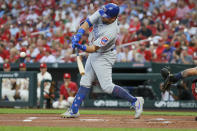 Chicago Cubs' Kyle Schwarber swings for a solo home run during the first inning of a baseball game against the St. Louis Cardinals, Saturday, Sept. 28, 2019, in St. Louis. (AP Photo/Scott Kane)