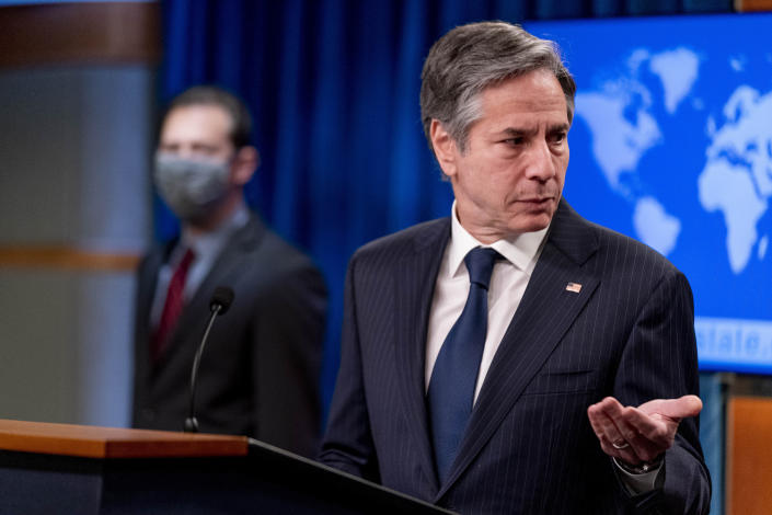 Secretary of State Antony Blinken, right, accompanied by International Religious Freedom Senior Official Dan Nadel, left, speaks at a news conference to announce the annual International Religious Freedom Report at the State Department in Washington, Wednesday, May 12, 2021. (AP Photo/Andrew Harnik, Pool)