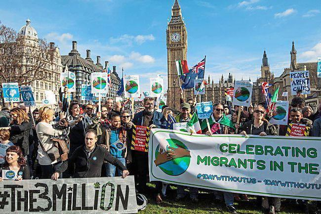 Hear our voices: protesters supporting migrant-worker rights gather outside Parliament