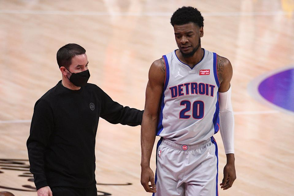 Detroit Pistons guard Josh Jackson (20) is helped off the court after being injured during the second quarter against the Washington Wizards at Little Caesars Arena on April 1, 2021.