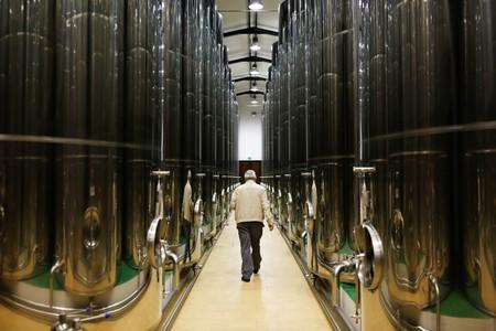 A man walks in a cellar in an olive oil cooperative in Porcuna, southern Spain