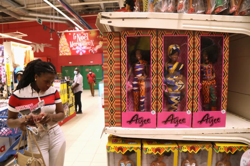 Naima brand dolls are seen in a toy department at the Carrefour supermarket in Abidjan