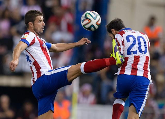 Atletico Madrid captain Gabi (L) during the Spanish Supercopa second-leg match against Real Madrid in Madrid on August 22, 2014 (AFP Photo/Dani Pozo)