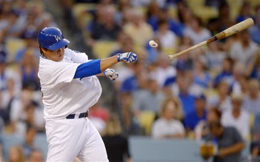 Los Angeles Dodgers' Ryu Hyun-Jin, of Korea, loses his bat into the stands as he swings during the second inning of their baseball game against the Philadelphia Phillies, Saturday, June 29, 2013, in Los Angeles. (AP Photo/Mark J. Terrill)