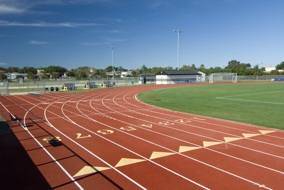 High school running track and football field.