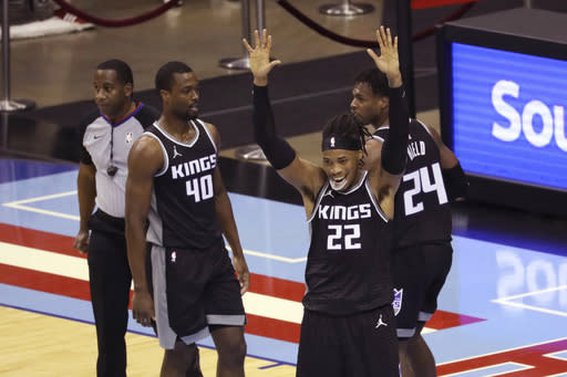 Sacramento Kings forward Richaun Holmes reacts after being called for a foul against the Houston Rockets during the first half of an NBA basketball game Thursday, Dec. 31, 2020, in Houston. (AP Photo/Richard Carson)
