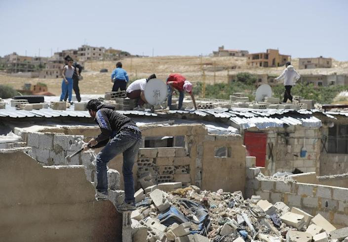 The demolition order threatens to make thousands of children homeless according to aid groups (AFP Photo/JOSEPH EID)