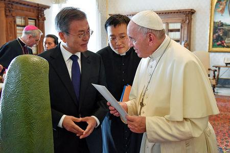 Pope Francis meets South Korean President Moon Jae-in during a private audience at the Vatican