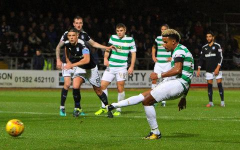 Despite the cloudburst which preceded this Betfred Cup tie, there were no slips by Celtic at Dens Park as they cruised past Dundee into the semi-final draw, to be made after Motherwell and Aberdeen meet in Lanarkshire this evening. The holders scarcely had to exert themselves after they established a secure advantage with a double from James Forrest and contributions from Scott Sinclair and Callum McGregor. The exercise was effectively a pleasant warm-up before the two high profile contests which appear next on Celtic's schedule, when the short trip to Ibrox for the first Old Firm derby of the campaign is followed by a European expedition to face Anderlecht in Brussels. Juggling the demands of defending the three Scottish honours as well as attempting to gain a toehold in the Champions League group stage, Brendan Rodgers made six changes to the side who cruised to a 4-0 home league victory over Ross County at the weekend. Most notably, Dedryck Boyata made his first appearance of the season with a welcome return to central defence. Mikael Lustig, Olivier Ntcham, Scott Sinclair, Kieran Tierney and Patrick Roberts were also restored after being rested against County, with Anthony Ralston, Stuart Armstrong, Tom Rogic, Jonny Hayes on the bench and Jozo Simunovic and Moussa Dembele granted a breather. Dundee, with no comparable resources, featured two personnel switches, with Roarie Deacon and Moussa Sofien replaced by Randy Wolters and Mark O'Hara. Sinclair opens the scoring from the spot Credit: Getty images Wolters featured in the referee's notebook midway through the first half when he clattered Sinclair, who otherwise looked very difficult to stop as he made repeated assaults on the Dundee defence, another of which saw the winger toppled by Jack Hendry inside the box for a penalty kick that was disputed hotly by the centre-back. Sinclair stroked his conversion efficiently past Scott Bain to garnish Celtic's 70% share of possession and he was joined on the scoresheet 