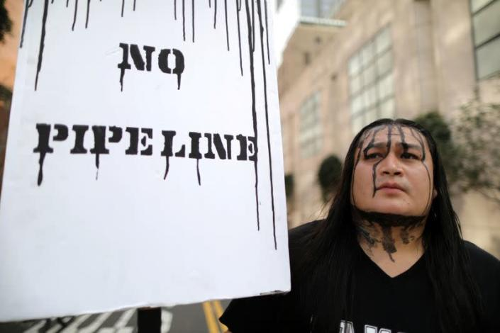 FILE PHOTO: People protest against President Donald Trump's executive order fast-tracking the Keystone XL and Dakota Access oil pipelines in Los Angeles