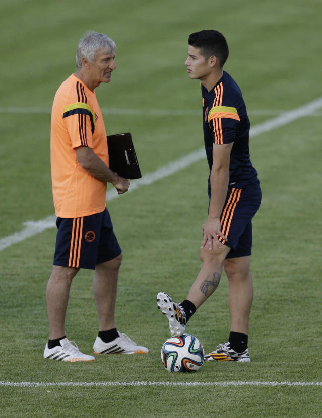 Colombia's James Rodriguez, right, talks to his coach Jose Pekerman during a training session the day before the World Cup quarterfinals soccer match between Colombia and Brazil in Fortaleza, Brazil, Thursday, July 3, 2014. (AP Photo/Natacha Pisarenko)