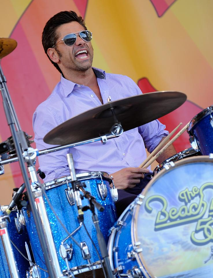 NEW ORLEANS, LA - APRIL 27:  Actor John Stamos joins The Beach Boys on stage and performs during the 2012 New Orleans Jazz & Heritage Festival Presented by Shell at the Fair Grounds Race Course on April 27, 2012 in New Orleans, Louisiana.  (Photo by Rick Diamond/Getty Images)