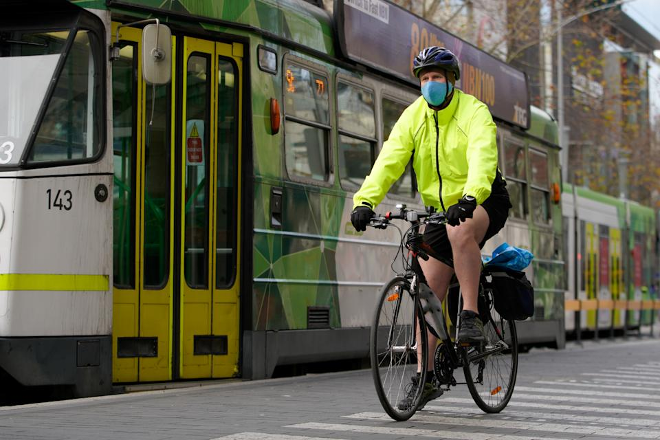 A cyclist wears a protective face mask in Melbourne.
