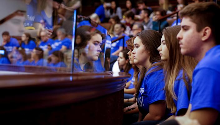 <p>Students from Marjory Stoneman Douglas High School, wearing blue t-shirts, look on from the gallery above the Florida Senate after the Senate honored the victims of last week's mass shooting on their campus, in Tallahassee, Fla., Feb. 21, 2018. (Photo: Colin Hackley/Reuters) </p>