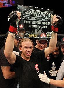 Jonanthan Brookins shows off The Ultimate Fighter 12 championship plaque after defeating Michael Johnson in Saturday night's final