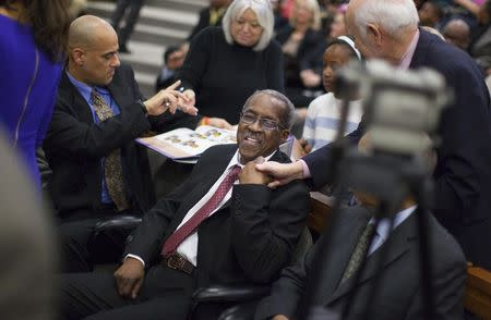 """James F. Wells (C) greets supporters after a group of black civil rights protesters nicknamed the """"Friendship Nine"""" appeared at a courthouse to have their trespassing convictions vacated in Rock Hill, South Carolina January 28, 2015.   REUTERS/Jason Miczek"""