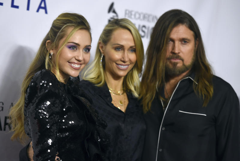 Miley Cyrus, from left, Tish Cyrus and Billy Ray Cyrus arrive at MusiCares Person of the Year honoring Dolly Parton on Friday, Feb. 8, 2019, at the Los Angeles Convention Center. (Photo by Jordan Strauss/Invision/AP)
