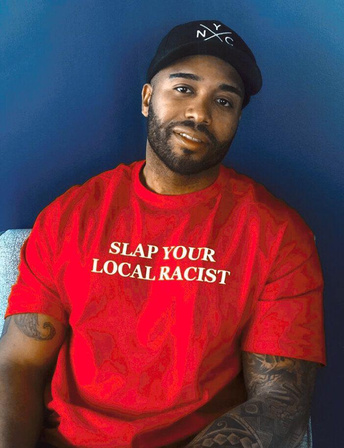 "Get the <a href=""https://americahates.us/shopahus/slap-your-local-racist"" target=""_blank"" rel=""noopener noreferrer"">""Slap Your Local Racist"" T-shirt from America Hates Us for $30</a>"