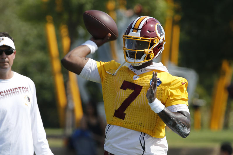 Washington Redskins quarterback Dwayne Haskins Jr. (7) tosses a pass during NFL football training camp in Richmond, Va., Friday, July 26, 2019. (AP Photo/Steve Helber)