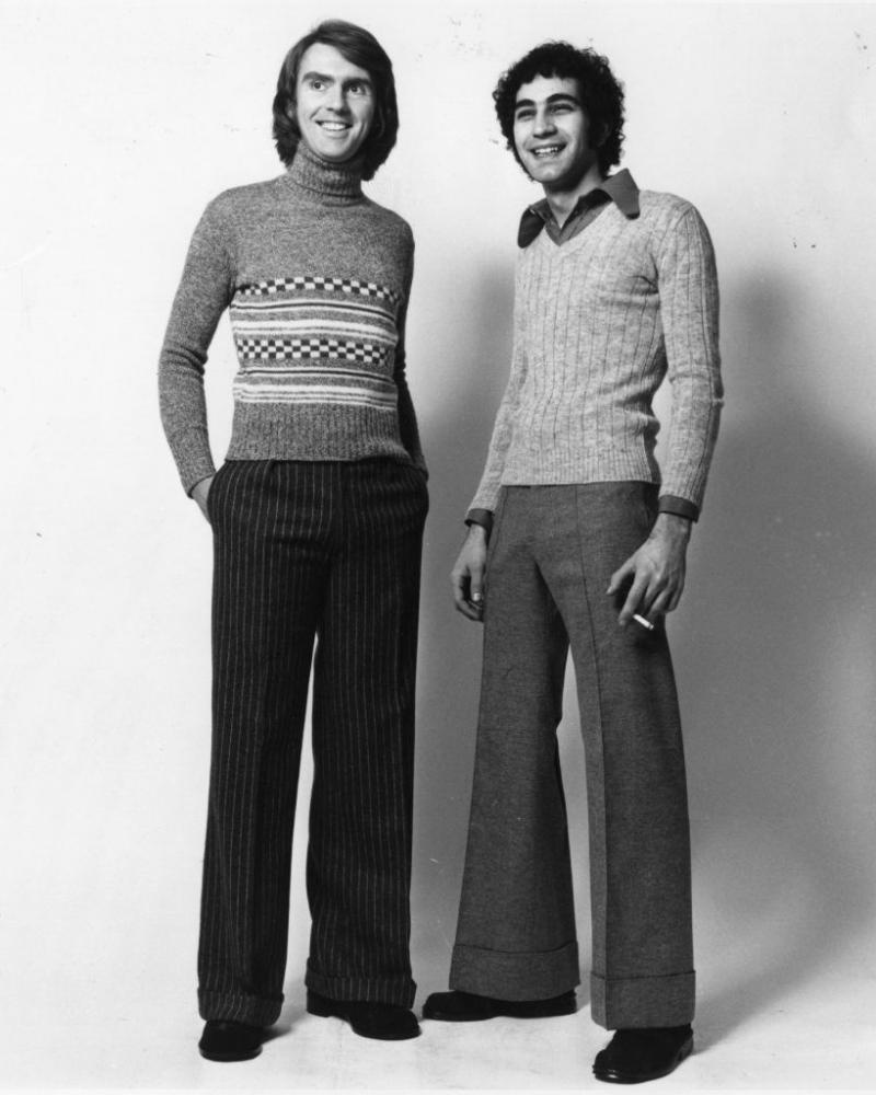 70s models wearing flared trousers