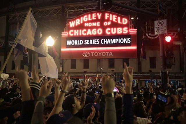 Fans celebrate outside Wrigley Field as the Cubs win their first World Series since 1908. (Getty Images)