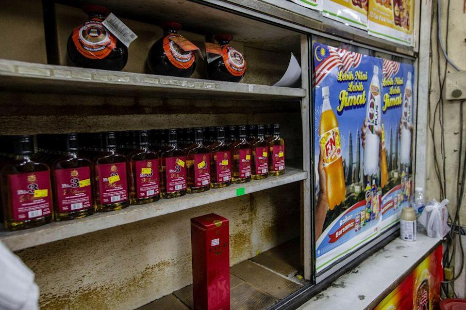 Beverages containing alcohol are placed in a separate shelf away from other regular drinks at Kedai Runcit, Ubat dan Arak Yee Hong in Sentul. — Picture by Firdaus Latif
