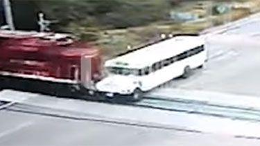 The bus can be seen edging toward the railway, trying to beat the oncoming train. Photo: Supplied