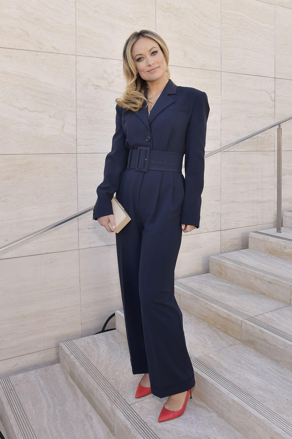 <p>As a THR Power 100 guest editor, Wilde looked to mean business with her structured jumpsuit, accessorised with a pair of red heeled shoes and a cream-coloured clutch bag. </p>