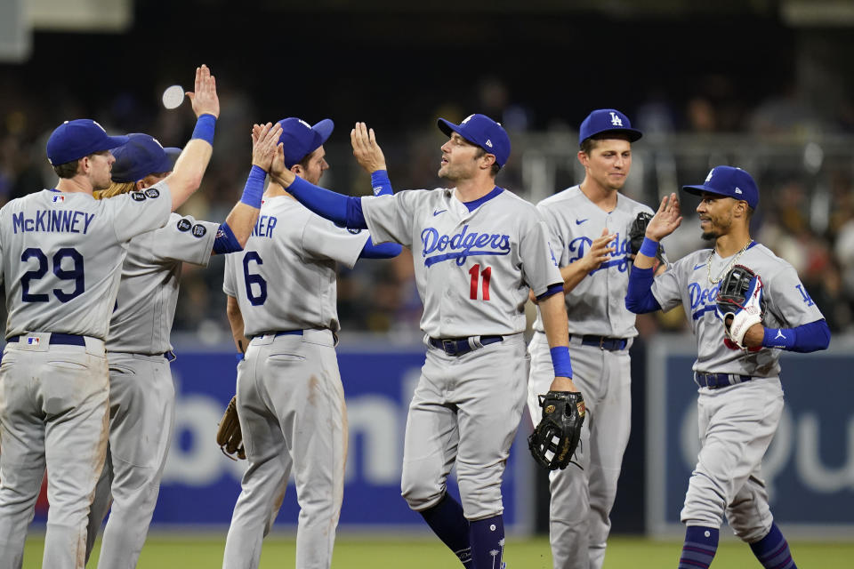 Los Angeles Dodgers left fielder AJ Pollock (11) celebrates with teammates after the Dodgers defeated the San Diego Padres 4-0 in a baseball game Thursday, Aug. 26, 2021, in San Diego. (AP Photo/Gregory Bull)