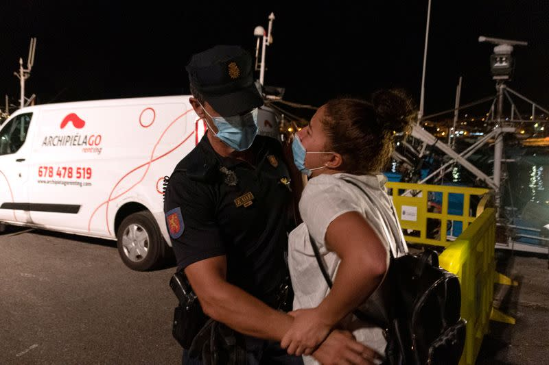 Sarah Bettache is stopped by a Spanish National Police officer as she tries to find her brother Ahmed, a migrant from Morocco, in the port of Arguineguin